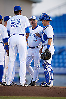 Dunedin Blue Jays pitching coach Mark Riggins (29) talks with his players on the mound during a game against the St. Lucie Mets on April 19, 2017 at Florida Auto Exchange Stadium in Dunedin, Florida.  Dunedin defeated St. Lucie 9-1.  (Mike Janes/Four Seam Images)