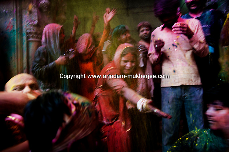 Indian people celebrating Holi at Banke Bihari temple in Vrindavan. Holi is the Hindu festival of colours. Every year at the begining of spring this festival takes place throughout India.The biggest celebration takes place in Banke Bihari temple Vrindavan.