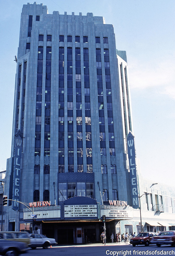 Los Angeles: Pellissier Building Wiltern Theater, 1930-31. Morgan, Walls & Clements. Art Deco style. Corner of Wilshire and Western. Clad in  blue-green glazed architectural terra-cotta tile.  Photo Dec. 1987.