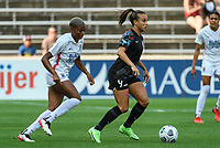 BRIDGEVIEW, IL - JULY 18: Mallory Pugh #9 of the Chicago Red Stars dribbles the ball as Tziarra King #23 of the OL Reign defends during a game between OL Reign and Chicago Red Stars at SeatGeek Stadium on July 18, 2021 in Bridgeview, Illinois.