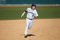 Joe Butts (10) of the Catawba Indians hustles towards third base against the West Virginia State Yellow Jackets at Newman Park on February 9, 2020 in Salisbury, North Carolina. The Indians defeated the Yellow Jackets 15-9 in game one of a doubleheader.  (Brian Westerholt/Four Seam Images)