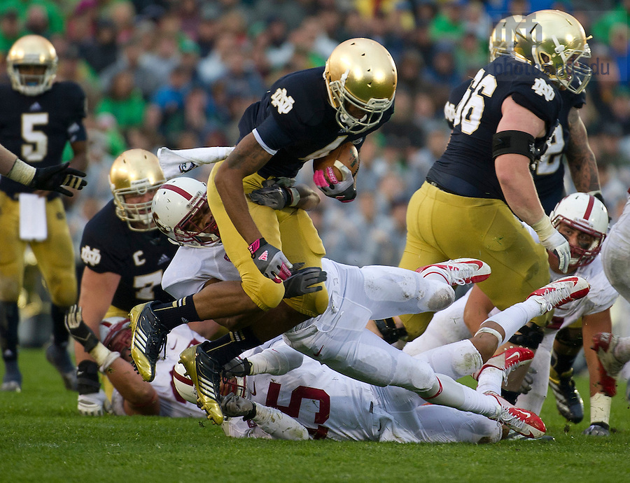 Oct. 13, 2012; Notre Dame running back George Atkinson III gains yardage before getting tackled by Stanford free safety Devon Carrington during the third quarter at Notre Dame Stadium. Photo by Barbara Johnston/University of Notre Dame