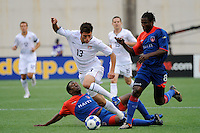 Colin Clark (13) of the United States (USA) fights through a tackle during the first half of a CONCACAF Gold Cup Group B group stage match between the United States and Haiti at Gillette Stadium in Foxborough, MA, on July 11, 2009. .