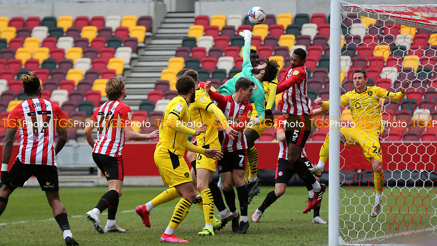 Brentford goalkeeper, David Raya, fingertips the ball away to foil a Barnsley attack during Brentford vs Barnsley, Sky Bet EFL Championship Football at the Brentford Community Stadium on 14th February 2021