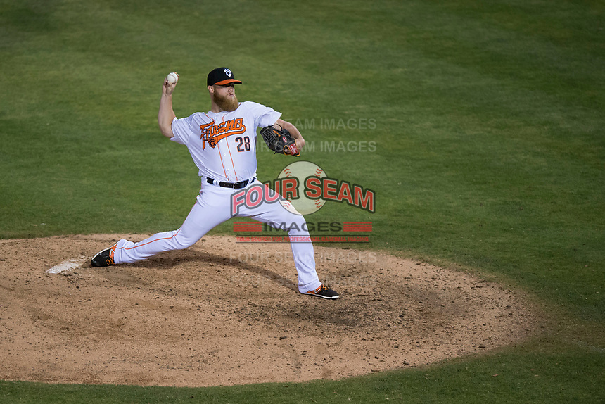 Fresno Grizzlies relief pitcher Matt Ramsey (28) delivers a pitch to the plate during a Pacific Coast League game against the Salt Lake Bees at Chukchansi Park on May 14, 2018 in Fresno, California. Fresno defeated Salt Lake 4-3. (Zachary Lucy/Four Seam Images)