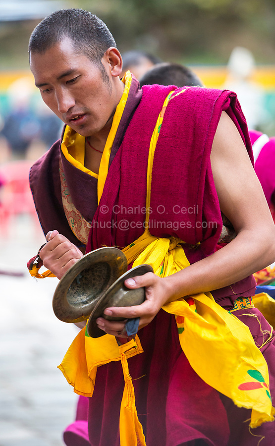 Prakhar Lhakhang, Bumthang, Bhutan.  Bhutanese Buddhist Monk Dancing with Cymbals in the Duechoed Religious Festival.