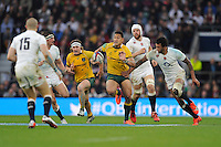 Israel Folau of Australia breaks past Courtney Lawes of England in midfield during the QBE International match between England and Australia at Twickenham Stadium on Saturday 29th November 2014 (Photo by Rob Munro)