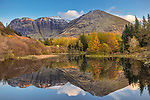 Glencoe, Scotland: A small pond with fall reflections and the mountains of Glen Coe