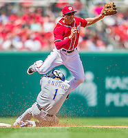 1 June 2014: Washington Nationals second baseman Danny Espinosa turns a double-play against the Texas Rangers at Nationals Park in Washington, DC. The Rangers shut out the Nationals 2-0 to salvage the third the third game of their 3-game inter-league series. Mandatory Credit: Ed Wolfstein Photo *** RAW (NEF) Image File Available ***