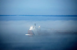 A ship passes through the fog off the north shore of Rock Island, the northern most island off the Door County peninsula on July 16, 2007..