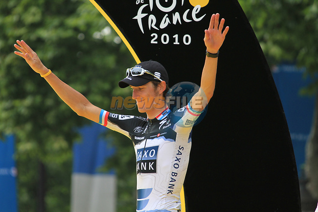 Andy Schleck (LUX) Saxo Bank on the podium after winning the young riders White Jersey and finishing 2nd overall at the end of the final Stage 20 of the 2010 Tour de France running 102.5km from Longjumeau to Paris Champs-Elysees, France. 25th July 2010.<br /> (Photo by Eoin Clarke/NEWSFILE).<br /> All photos usage must carry mandatory copyright credit (© NEWSFILE | Eoin Clarke)