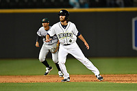 Right fielder Gene Cone (9) of the Columbia Fireflies takes a lead off second in a game against the Augusta GreenJackets on Opening Day, Thursday, April 6, 2017, at Spirit Communications Park in Columbia, South Carolina. Shortstop Brandon Van Horn (7) is defending. Columbia won, 14-7. (Tom Priddy/Four Seam Images)