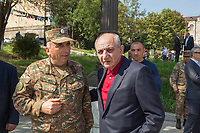 Nagorno-Karabakh, also known as Artsakh, is a landlocked region in the South Caucasus. Stepanakert is the capital and the largest city of the Republic of Artsakh (better known as Nagorno-Karabakh). Bako Sahakyan (R), the president of Artsakh, and a high ranking military officer (L). Bako Sahakyan (born 30 August 1959) is the third president of the de facto Republic of Artsakh. He was first elected as President on 19 July 2007. On 19 July 2012 he was re-elected for a second five-year term, receiving approximately two-thirds of the votes. In 2017 he was re-elected indirectly for a three-year term. Both men came on a sunny Sunday morning at War Memorial attending a ceremony for Ashot  Ghulyan (1959-1992), also known as Bekor (Shard). He was an Armenian military leader, killed during the Nagorno-Karabakh war (1988 -1994), and awarded the Hero of Artsakh honorary title. Since 1994, regular peace talks between Armenia and Azerbaijan mediated by the OSCE Minsk Group have failed to result in a peace treaty. Nagorno-Karabakh is a disputed territory, internationally recognized as part of Azerbaijan, but most of the region is governed by the Republic of Artsakh (formerly named Nagorno-Karabakh Republic), a de facto independent state with Armenian ethnic population. The territory is under the control of the Artsakh Defense Army (which is backed up by Armenian Army) due to the ongoing territorial disputes with Azerbaijan. 6.10.2019 © 2019 Didier Ruef