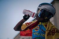 Yoel Asmeron Tesfasilasie (ERI) rehydrating straight after finishing<br /> <br /> MEN JUNIOR INDIVIDUAL TIME TRIAL<br /> Hall-Wattens to Innsbruck: 27.8 km<br /> <br /> UCI 2018 Road World Championships<br /> Innsbruck - Tirol / Austria
