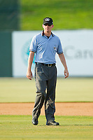 Umpire Ryan Wills handles the calls on the bases during the South Atlantic League game between the Rome Braves and the Kannapolis Intimidators at CMC-Northeast Stadium on June 16, 2013 in Kannapolis, North Carolina.  The Intimidators defeated the Braves 6-4.   (Brian Westerholt/Four Seam Images)