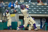 Kitt Capell (12) of the Western Carolina Catamounts follows through on his swing against the Saint Joseph's Hawks at TicketReturn.com Field at Pelicans Ballpark on February 23, 2020 in Myrtle Beach, South Carolina. The Hawks defeated the Catamounts 9-2. (Brian Westerholt/Four Seam Images)