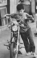 1973 FILE PHOTO -<br /> <br /> Boy with a motorbike; Honda is still symbol of capitalist good life