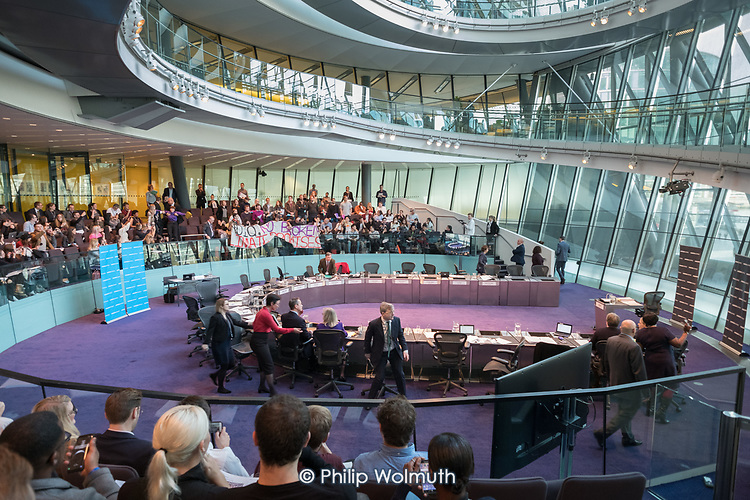 London Assembly members leave the chamber as Switched On London environmental campaigners bring Mayor's Question Time to a standstill to demand Mayor Sadiq Khan keeps his climate promises. City Hall, London.