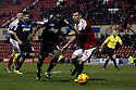 Francois Zoko of Stevenage battles with Grant Hall of Swindon <br />  - Swindon Town v Stevenage - Johnstone's Paint Trophy - Southern Section Semi-final  - County Ground, Swindon - 10th December, 2013<br />  © Kevin Coleman 2013