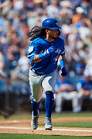Toronto Blue Jays shortstop Freddy Galvis (16) runs to first base during a Grapefruit League Spring Training game against the New York Yankees on February 25, 2019 at George M. Steinbrenner Field in Tampa, Florida.  Yankees defeated the Blue Jays 3-0.  (Mike Janes/Four Seam Images)