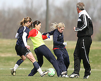 Head coach Jim Gabarra watches Homare Sawa tangle with Christen Karniski and Emily Janss during Washington Freedom  practice and media event at the Maryland Soccerplex on March 25 in Boyd's, Maryland.