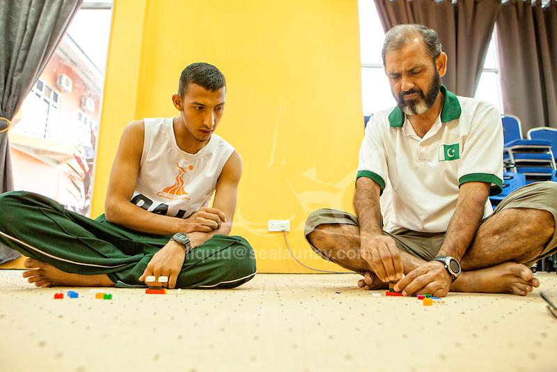 ISAF Emerging Nations Program, Langkawi, Malaysia.<br />Muhammad Akram Tariq from Pakistan & Muhammad Uzair from Pakistan.<br />Laser, Sail Number: PAK 13