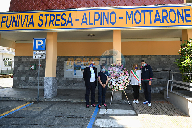 The Giro pays tribute to the victims of the Mottarone cable car tragedy the CEO of RCS Sport, Paolo Bellino, the Director of the Giro d'Italia, Mauro Vegni, and the Director of the Giro-E, Roberto Salvador, together with the Mayor of Stresa, Marcella Severino, laid a wreath at the base of the Stresa-Mottarone cable car during Stage 19 of the 2021 Giro d'Italia, running 176km from Abbiategrasso to Alpe Di Mera (Valsesia), Italy. 28th May 2021.  <br /> Picture: LaPresse/Gian Mattia D'Alberto | Cyclefile<br /> <br /> All photos usage must carry mandatory copyright credit (© Cyclefile | LaPresse/Gian Mattia D'Alberto)