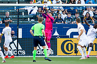 CARSON, CA - JUNE 19: Jonathan Bond #1 of the Los Angeles Galaxy clears the ball out of the box during a game between Seattle Sounders FC and Los Angeles Galaxy at Dignity Health Sports Park on June 19, 2021 in Carson, California.