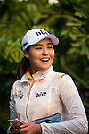 In-Gee Chun of Korea is interviewed during the Hyundai China Ladies Open 2014 at World Cup Course in Mission Hills Shenzhen on December 14 2014, in Shenzhen, China. Photo by Li Man Yuen / Power Sport Images
