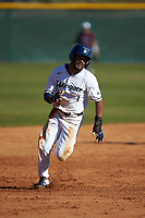 Justin Guy (1) of the Wingate Bulldogs hustles towards third base against the Concord Mountain Lions at Ron Christopher Stadium on February 2, 2020 in Wingate, North Carolina. The Mountain Lions defeated the Bulldogs 12-11. (Brian Westerholt/Four Seam Images)