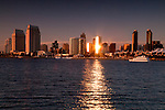 Sun reflecting off the San Diego skyline at dusk
