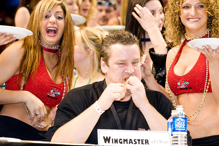 """""""Wingmaster"""" at the 14th annual Wing Bowl, held in Philadelphia on February 3, 2006 at the Wachovia Center.<br /> <br /> The Wing Bowl is a competitive eating event in which eaters try and down the most hot wings in 30 total minutes in front of a crowd of 10,000 plus people.  The real show however is all around the eaters, from the various scantily clad women (known as """"Wingettes"""") that make up eaters' entourages, to the behavior of the fans themselves."""