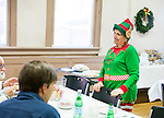 "Naugatuck, CT- 25 December 2016-122516CM02-  Volunteers Shoshe Drapin of Naugatuck chats with guests   during a Christmas Dinner at Saint Michael's Church.  ""It's hard to be alone on the holiday, but here you're with family."" said Drapin.  Approximately 400 meals were served, both in-house and delivered said Mike Kelly, director of the event.  He said dinner included fresh  turkey, ham, carrots, turnips, mashed potatoes, homemade desserts, eggnog and a barista serving up various coffee drinks.     Christopher Massa Republican-American"