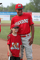 Batavia Muckdogs shortstop Yunier Castillo #7 poses for photos with a fan during the teams pre-season pep rally at Dwyer Stadium on June 15, 2011 in Batavia, New York.  Photo By Mike Janes/Four Seam Images