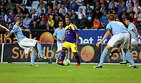 Thursday 08 August 2013<br /> Pictured: Wayne Routledge of Swansea (C) passing the ball past Erdal Rakip (L) and Pontus Jansson (R) of Malmo<br /> Re: Malmo FF v Swansea City FC, UEFA Europa League 3rd Qualifying Round, Second Leg, at the Swedbank Stadium, Malmo, Sweden.