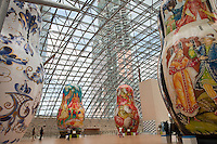 Moscow, Russia, 15/06/2011..People walk through an exhibition of of giant Russian matryoshki, or nesting dolls, in the newly-opened Afimall shopping centre. The dolls, designed by Boris Krasnov, are from 6 to 13 metres high, and each is decorated in a different style of traditional Russian folk art..Left - right: Gzhel, Mstero, Ornamental Zhostovo painting, and Palekh styles..