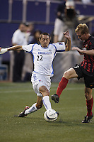 The Wizard's Davy Arnaud and the MetroStars' Chris Leitch go for a ball. The Kansas City Wizards were defeated by  the NY/NJ MetroStars to a 1 to 0 at Giant's Stadium, East Rutherford, NJ, on May 30, 2004.
