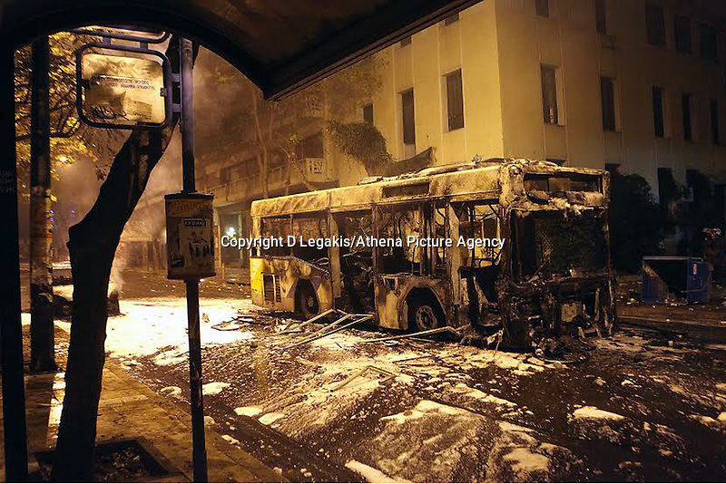 Pictured: A public city bus which had been set ablaze by protesters after being doused by fire extinguishing foam Tuesday 02 December 2014<br /> Re: At least 15 people have been arrested after a peaceful support rally for jailed hunger strike anarchist turned into violent confrontation with police. Authorities used tear gas and stun grenades to quell rioters carrying Molotov cocktails.<br /> As an estimated between 8,000 and 10,000 protesters marched through the central Athens shouting slogans in support of Nikos Romanos, the imprisoned anarchist who is staging a hunger strike as he demands the right to be able to attend university, anarchists' march got violent on the streets of Exarchia, downtown Athens.