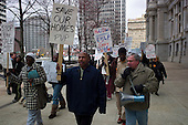 Philadelphia, Pennsylvania<br /> March 24, 2011<br /> <br /> Philadelphia area unemployed homeowners rally at City Hall to continue the stay of 3,000 properties listed for a Sheriff's sale on April 5.  Unemployed 99er Steve Nathan, grey hair-holding speaker, leads the rally on a march to the HUD office after being evicted from his home of 11 years in November 2010 and loosing his benefits in late 2010.<br /> <br /> Protesters were angered over the U.S. Department of Housing and Urban Development's (HUD) delay to implement the Emergency Homeowner Loan Program (EHLP), a $1 billion program enacted by Congress to assist homeowners and to prevent foreclosure. EHLP funds, to be obligated by September 30, 2011, are to provide mortgage payment assistance of up to 24 months to homeowners who have had at least 14% drop in income due to involuntary unemployment or underemployment caused by adverse economic conditions, medical emergency or serious injury.<br /> <br /> Philadelphia Unemployment Project (PUP) organized the rally.