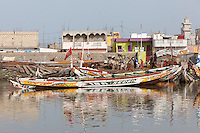 Senegal, Saint Louis.  Along the River Bank, Guet N'Dar Neighborhood.  Fishing Boats Tied up along the Senegal River.