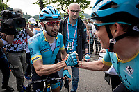 Dario Cataldo (ITA/Astana) wins Stage 15 from Ivrea to Como (232km) and is congratulated at the finish by teammate Miguel Angel Lopez (COL/Astana)<br /> <br /> 102nd Giro d'Italia 2019<br /> <br /> ©kramon