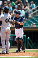 Montgomery Biscuits catcher Brett Sullivan (7) waits for Clint Coulter (40) to get set in the batter's box during a game against the Biloxi Shuckers on May 8, 2018 at Montgomery Riverwalk Stadium in Montgomery, Alabama.  Montgomery defeated Biloxi 10-5.  (Mike Janes/Four Seam Images)