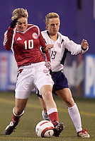 """Denmark's Anne Dot Eggers battles Kristine Lilly of the USA for the ball. The US Women's National Team tied the Denmark Women's National Team 1 to 1 during game 8 of the 10 game the """"Fan Celebration Tour"""" at Giant's Stadium, East Rutherford, NJ, on Wednesday, November 3, 2004.."""