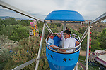 Meridith Joyce, 9, Edison Nguyen 15, and Amanda Joyce look from the top of the ferris wheel during the NV150 Fair at Fuji Park in Carson City, Nev., on Sunday, August 3, 2014.<br /> (Photo By Kevin Clifford)