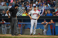 Auburn Doubledays manager Jerad Head (11) argues a call on a play at the plate with umpire Drew Saluga (left) during a game against the Batavia Muckdogs on July 4, 2017 at Dwyer Stadium in Batavia, New York.  Batavia defeated Auburn 3-2.  (Mike Janes/Four Seam Images)