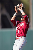 Oklahoma Sooners second baseman Hector Lorenzana #12 catches a pop up against the Texas Longhorns in the NCAA baseball game on April 6, 2013 at UFCU DischFalk Field in Austin, Texas. The Longhorns defeated the rival Sooners 1-0. (Andrew Woolley/Four Seam Images).