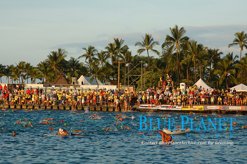 Age groupers swimmers prepare for the start of the 2004 Ironman Triathlon World Championship Volunteers line the pier Kailua Kona, Big Island, Hawaii, Pacific Ocean
