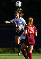 WINSTON-SALEM, NORTH CAROLINA - August 30, 2013:<br />  Erin Yenney (16) of Louisville University heads over Nicolette Young (28) of Virginia Tech during a match at the Wake Forest Invitational tournament at Wake Forest University on August 30. The game ended in a 1-1 tie.