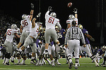 """The Washington State defensive front, Andy Mattingly (#45), Casey Hamlett (#96), Bernard Wolfgramm (#95), Anthony Laurenzi (#61) and Travis Long (#89), go sky-high to try to block a field goal attempt during the Cougars Pac-10 conference """"Apple Cup"""" showdown with arch-rival Washington at Husky Stadium in Seattle, Washington, on November 28, 2009.  The Cougars lost to the Huskies in the game, 30-0."""