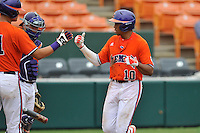 Redshirt freshman outfielder K.J. Bryant (10) (Wade Hampton High School) of the Clemson Tigers is congratulated after a home run during a fall practice intra-squad Orange-Purple scrimmage on Sunday, September 27, 2015, at Doug Kingsmore Stadium in Clemson, South Carolina. (Tom Priddy/Four Seam Images)